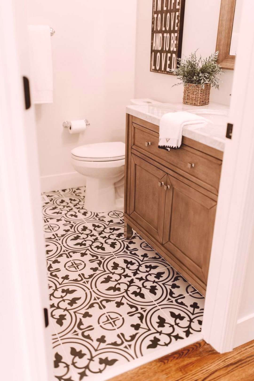 Black and white tile with a walnut vanity are perfection in this modern farmhouse style renovation