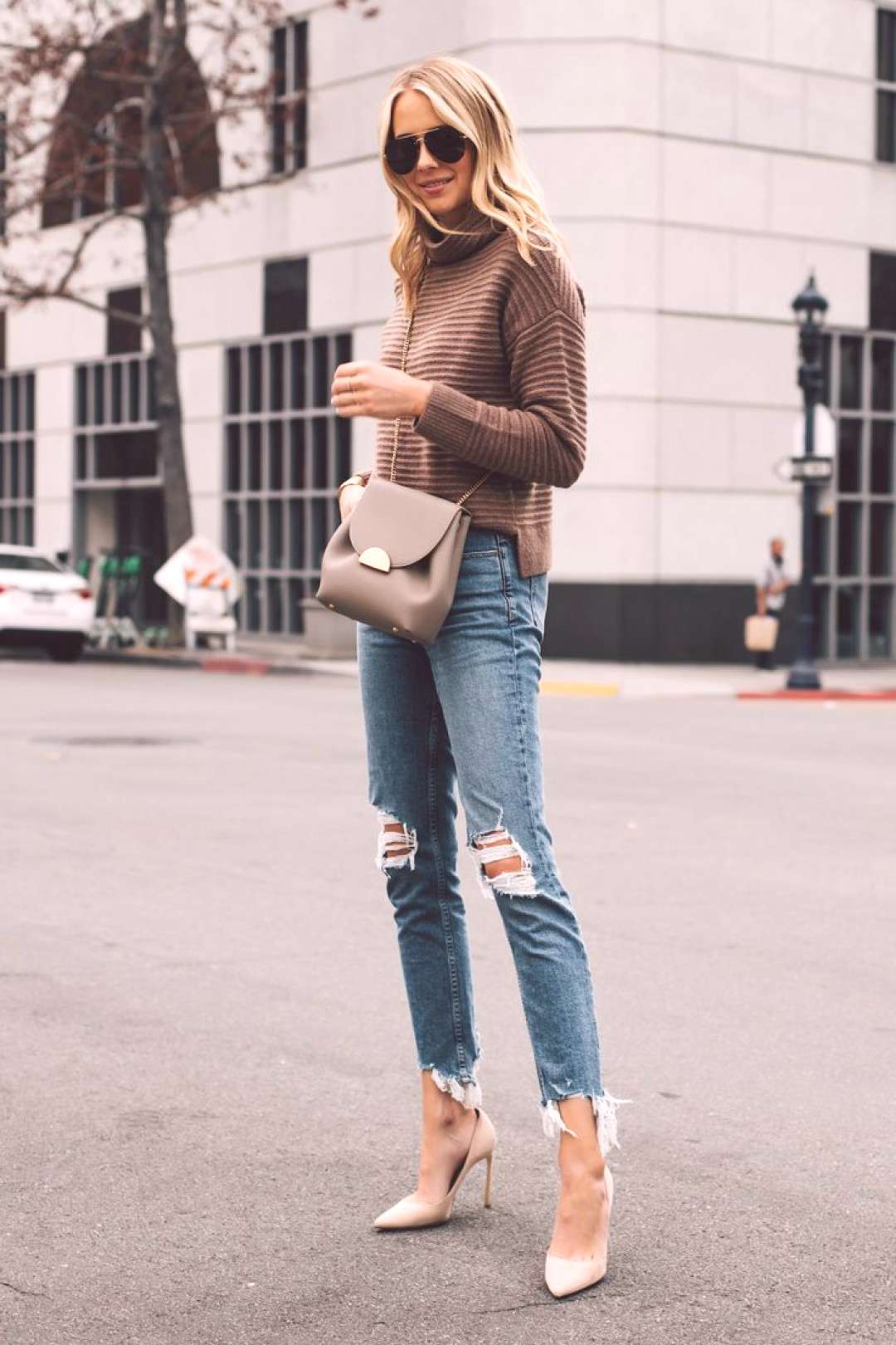 Blonde Woman Wearing Madewell Brown Mock Neck Sweater Paige Ripped Skinny Jeans Nude Pumps Polene G
