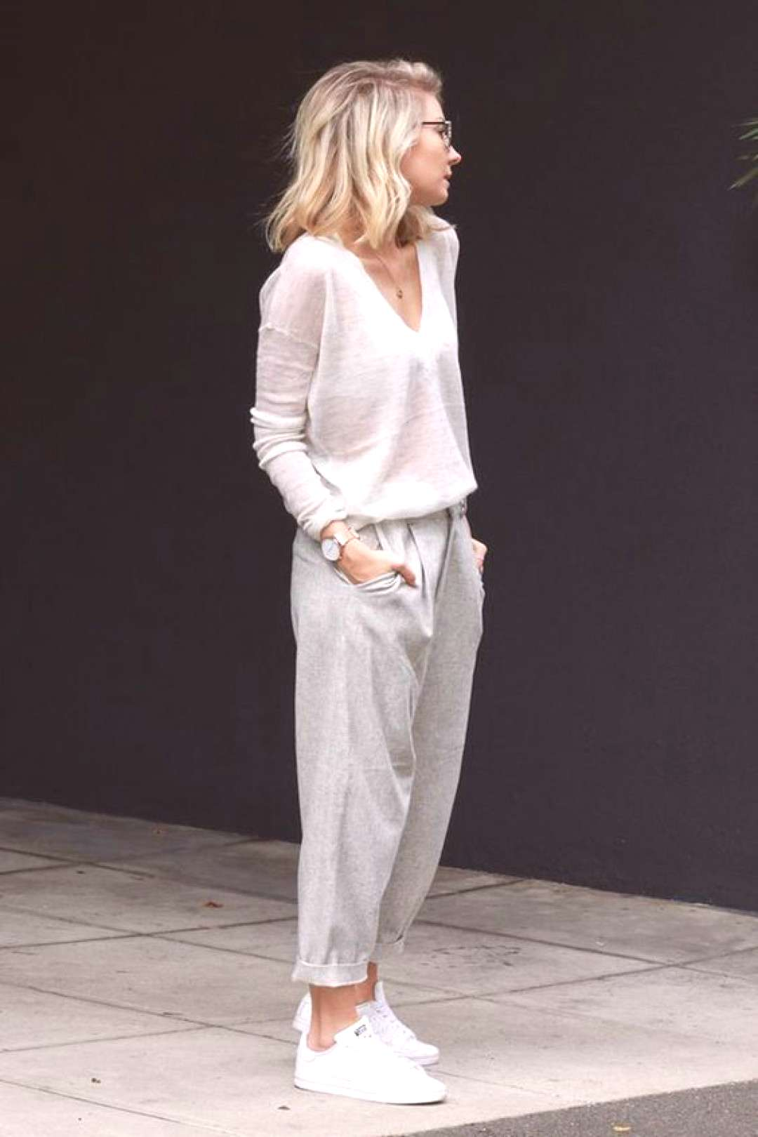 Lovely wispy light grays. Long sleeved v-neck translucent cashmere sweater in a color somewhere bet